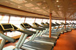 gym hall with  treadmills near windows in cruise ship