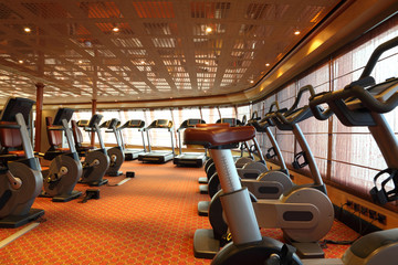 gym hall with treadmills and exercise bicycle in cruise ship