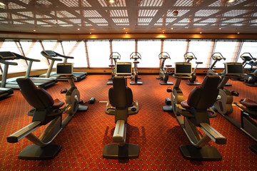 gym hall with exercise bicycle in cruise ship view