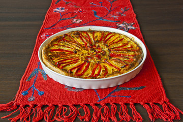 paprika pie on the red linen and wenge colour table