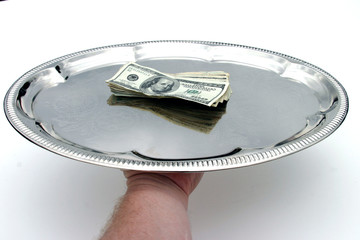 cash money served on a silver tray