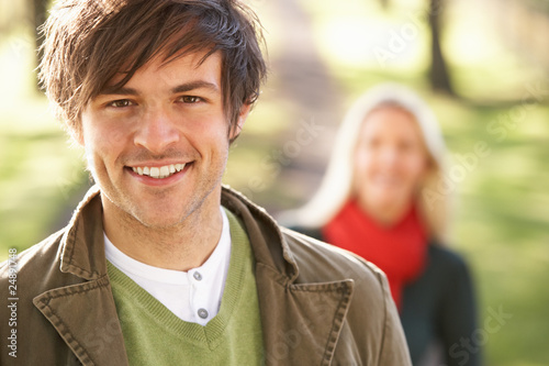 Portrait Of Romantic Young Couple In Autumn Park