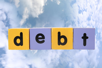 debt in toy play block letters with clipping path on clouds