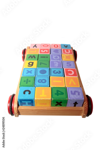 childrens play letter blocks in toy cart with clipping path