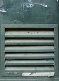 green metal grunge door with ventilation grid shaft poster