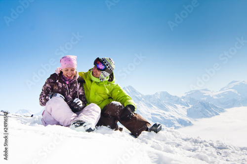 Young happy couple in winter mountains