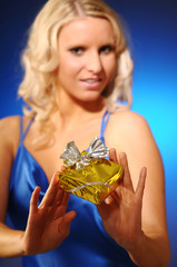 The beautiful young blond woman with present