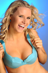 The attractive blond woman in the light blue wonderbra
