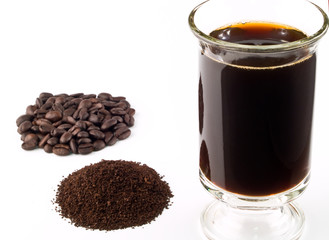 Coffee Beans Coffee Grounds and a Cup of Brewed Coffee