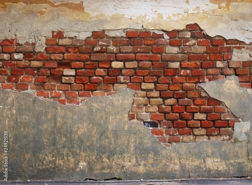 Stone wall of the old brick and plaster - 24921538