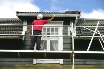 Man painting his house