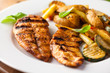 Grilled chicken breast with vegetables and basil