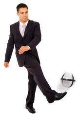 Businessman playing with a soccer ball isolated in white