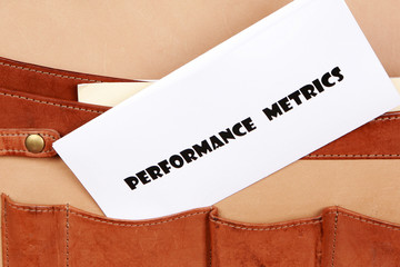 PERFORMANCE METRICS document in a briefcase
