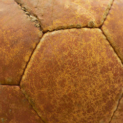 Leather texture of an old football ball, closeup shot.