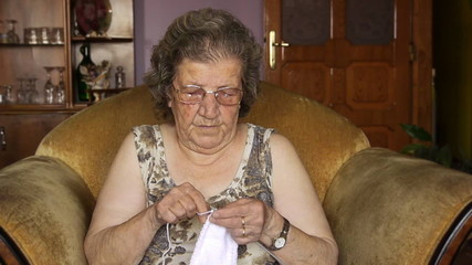 Old retired woman knitting in home - Leisure - Relaxation