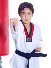 child practicing martial arts isolated on white background