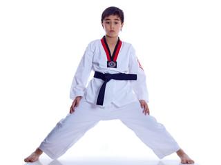 child exercising with legs apart