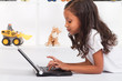 african american girl playing with laptop