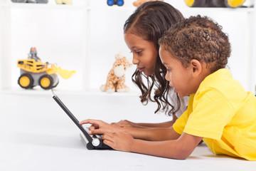 african american kids using laptop