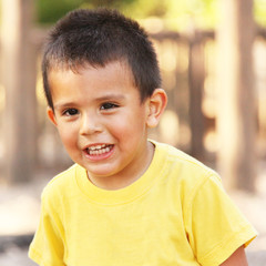 Little toddler boy smiling outdoor portrait
