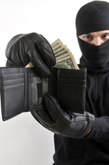 Robber  takes money from stolen wallet isolated on white .