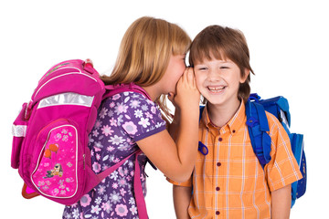 portrait of a blonde girl whispering in boy's ear
