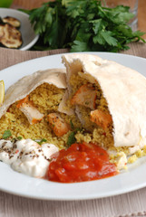 Pitta bread stuffed with chicken and couscous