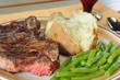 Dinner of steak, baked potato and green beans - 24967170