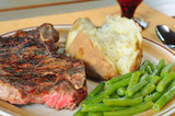 Dinner of steak, baked potato and green beans