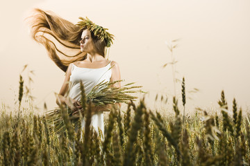 Young woman in the meadow