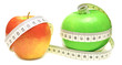 tape measure wrapped around green and red apple
