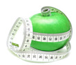 tape measure wrapped around green apple