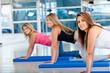 women in stretching class