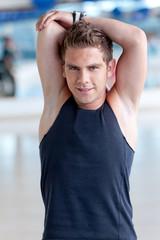 Gym man stretching