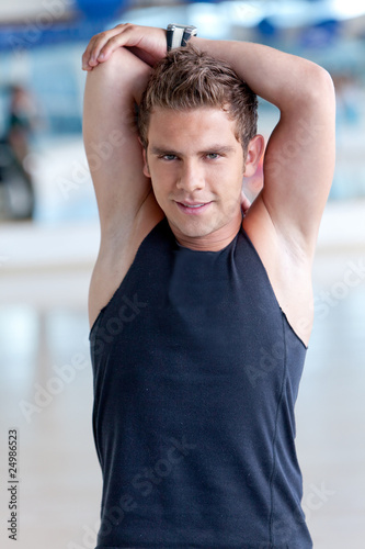 Gym man stretching