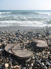 Beach scene with pair of flip flops