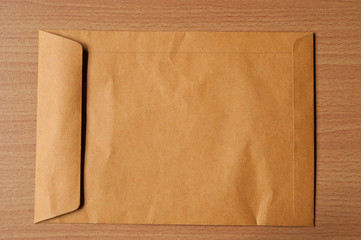 Close Brown Envelope document on wood background