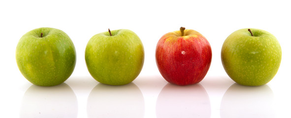 Green apples with one red one