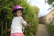 Cheerful girl riding a bike