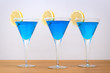 3 blue cocktails.