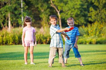 Preschool boy throwing frisbie