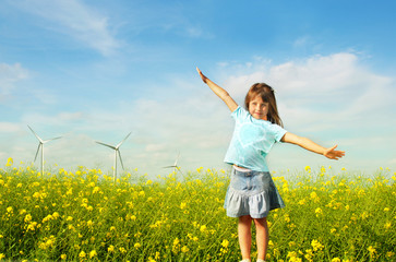 Little girl in front of windmills