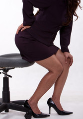 Attractive thirties asian business woman having backpain