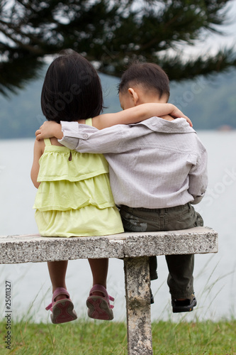Two little kids dating in a park