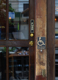 The disabled access sign from the entrance of a restaurant poster