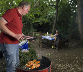 Bbq in the garden with man on foreground