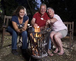 Family at campfire in the garden