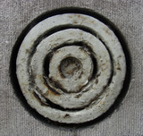 circular round rusty ventilation shaft in a gray stone wall poster