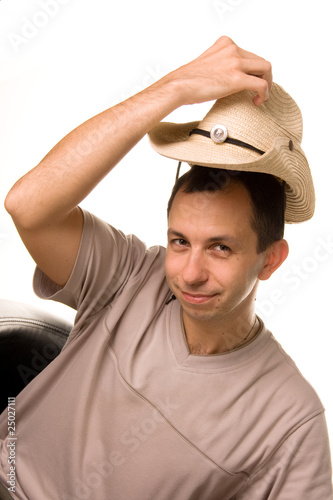A man puts a straw hat on a head